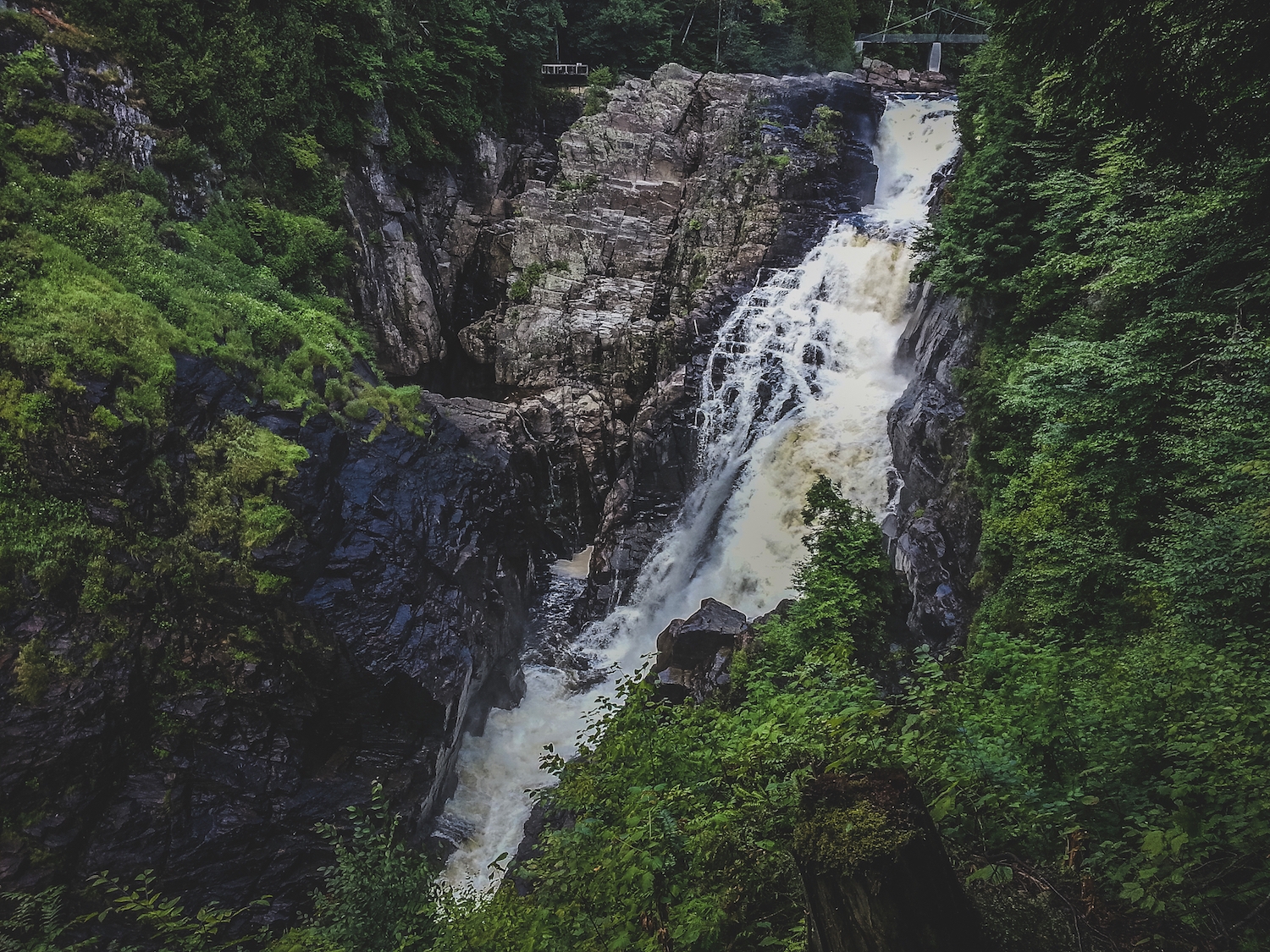 """Breathtaking gorge that drops 74 meters and is carved by the Sainte-Anne-du-Nord River, Beaupre, Quebec, Canada"" By Focqus via Shutterstock"