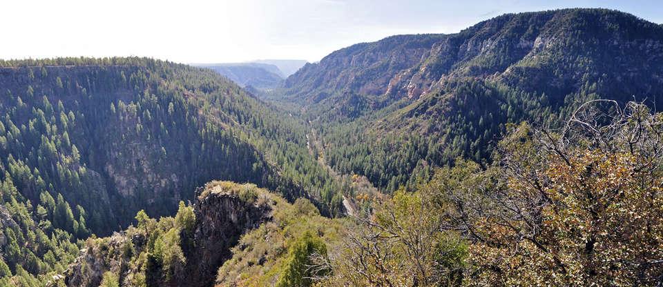 Ancient ruins and red rocks along Oak Creek Canyon